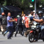A gunmen points his weapon during the attacks in Jakarta.