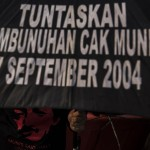 Human Rights activists display a banner, demanding that the government solve the murder case of rights champion Munir Said Thalib at a demonstration near the Merdeka Palace in Jakarta on Sept. 1. (Antara Photo/Sigid Kurniawan)