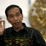 """Indonesian President Joko Widodo gestures during an interview with Reuters at the Presidential Palace in Jakarta, Indonesia, February 10, 2016. Indonesia on Thursday opened dozens of sectors to foreign investors in what President Joko Widodo has described as a """"Big Bang"""" liberalisation of its economy, Southeast Asia's largest. Picture taken February 10, 2016. REUTERS/Darren Whiteside  - RTX26FW2"""