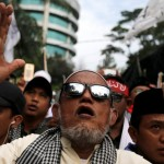 "Hardline Muslims react to the verdict in Basuki ""Ahok"" Purnama's blasphemy trial outside the court in Jakarta on May 9, 2017. Photo: Reuters"