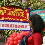 Indonesian walks past a farewell wreaths for Basuki Tjahaja Purnama also known as Ahok, Jakarta's first non-Muslim governor for half a century and its first ethnic Chinese leader, at cityhall in Jakarta, on May 10, 2017.  Jakarta's Christian governor was jailed for two years after being found guilty of blasphemy, in a shock decision that has stoked concerns over rising religious intolerance in the world's most populous Muslim-majority nation. Photo: AFP/BAY ISMOYO