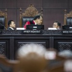 Constitutional Court judges Arief Hidayat (center), Anwar Usman (left) and Maria Farida Indrati (right) preside over a hearing at the court in Jakarta on April 4. (Antara/M Agung Rajasa)